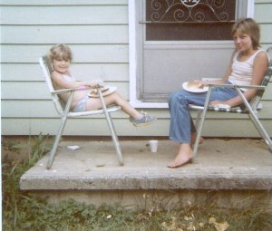 Carrie, sitting with Rona on grandpa's front porch in 1982.