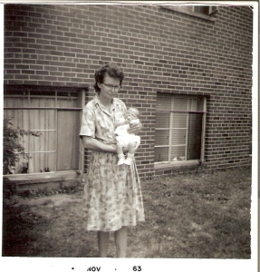 Mrs. Harvey, holding my brother, Roddy, June 1963, outside our apartment.